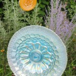 Light blue and golden orange glass garden ornaments